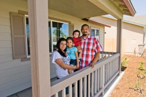 Self-Help Enterprises_de la Rosa family standing in front of the new home they built in Corcoran 2012
