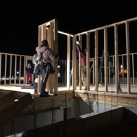 people building walls at night